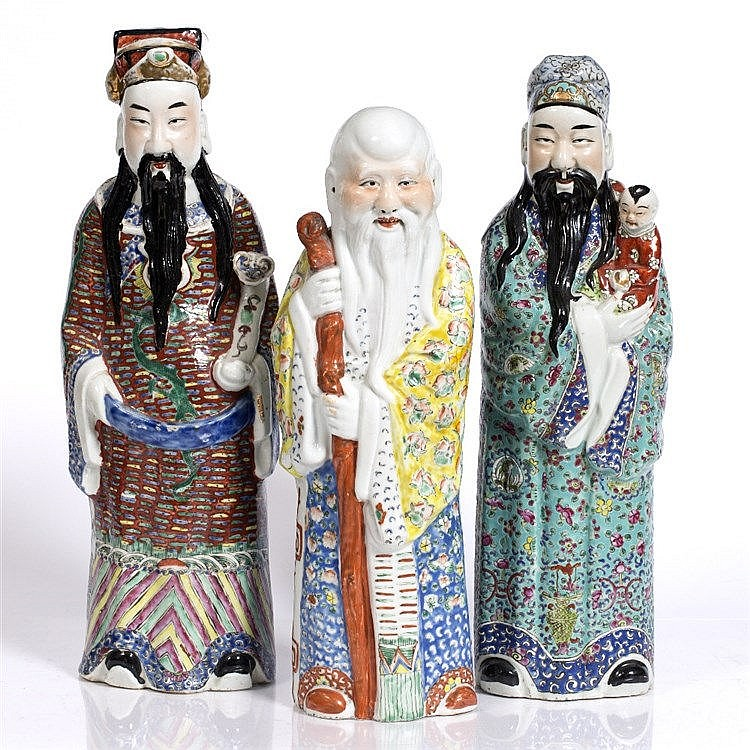 Three Chinese polychrome figures of Immortals