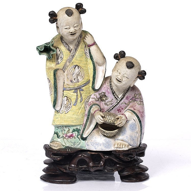 A Chinese porcelain group of two boys