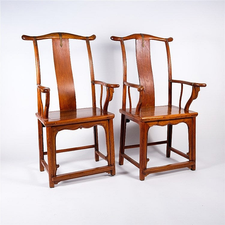 A pair of Chinese Ming style elm chairs