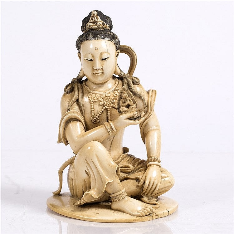 A Chinese carved ivory figure of Quanyin