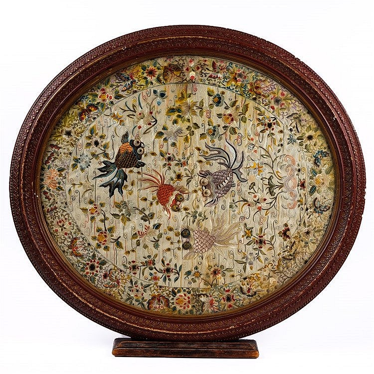 A Chinese oval silk embroidered panel
