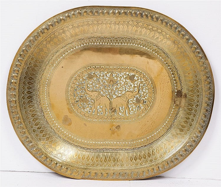 A large embossed Indian tray/table top