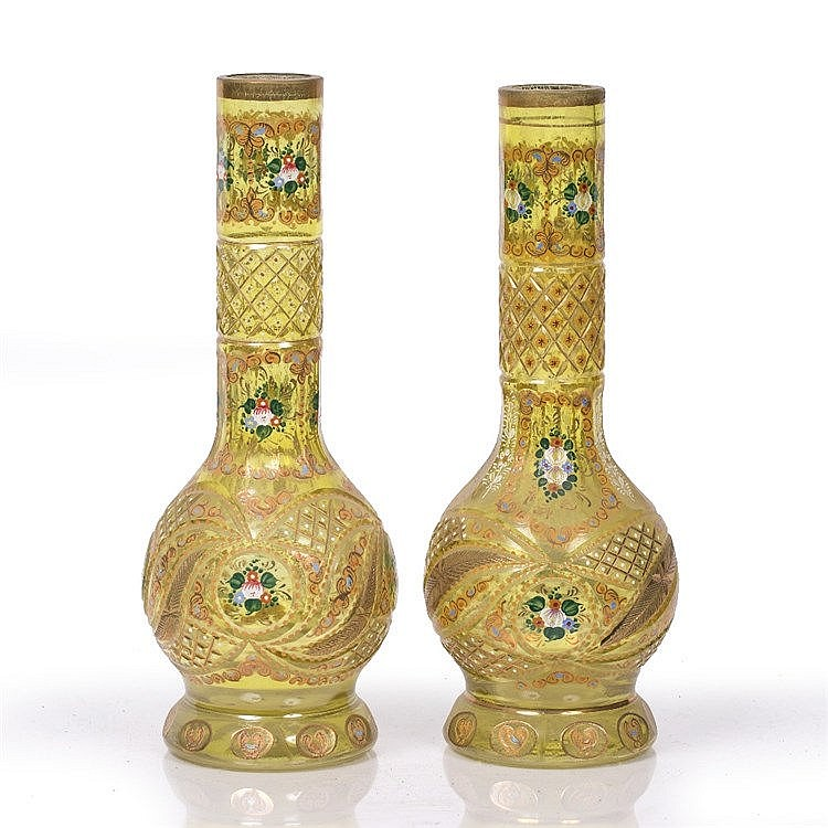 A harlequin pair of Bohemian Persian market cut-glass vases