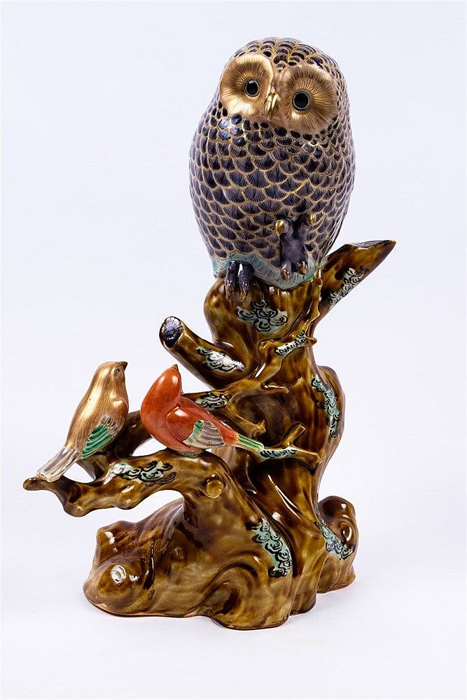 A Japanese Kutani porcelain sculpture of an owl and two song birds