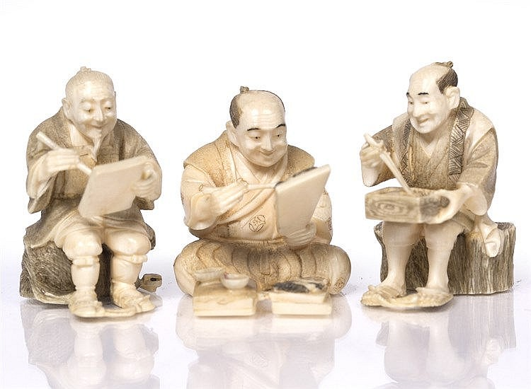 A Japanese set of three ivory okimono
