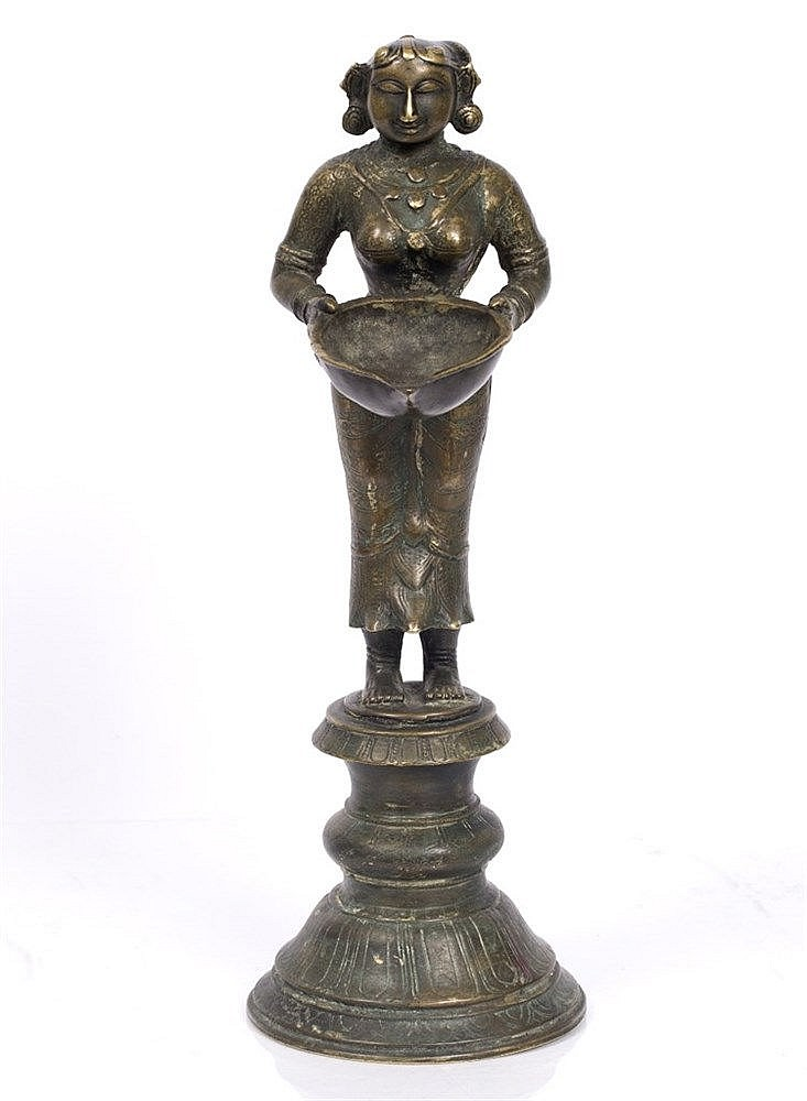 An Indian bronze Lakshmi figure