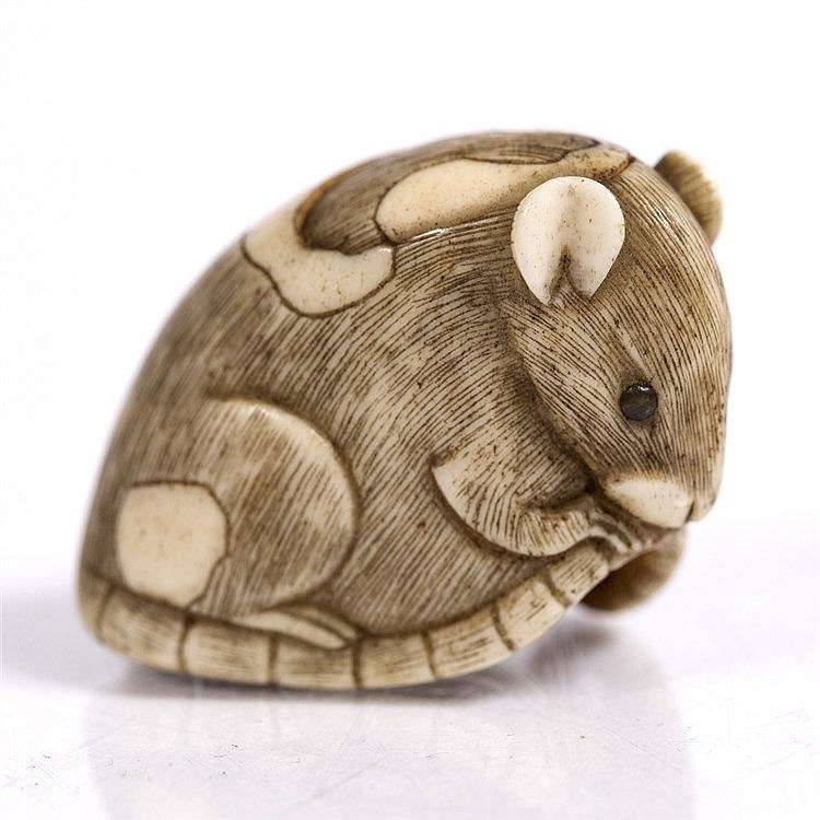 A Japanese ivory netsuke of a pie-bald rat