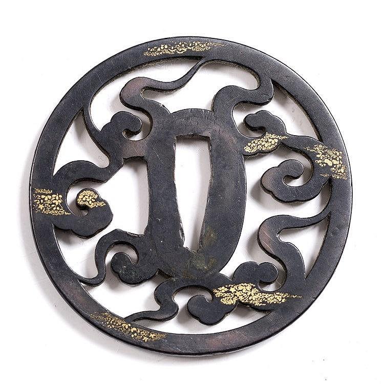 A Japanese bronze tsuba