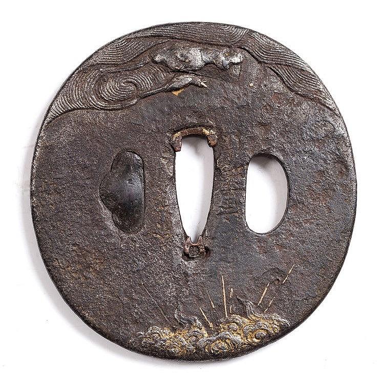 A Japanese iron tsuba