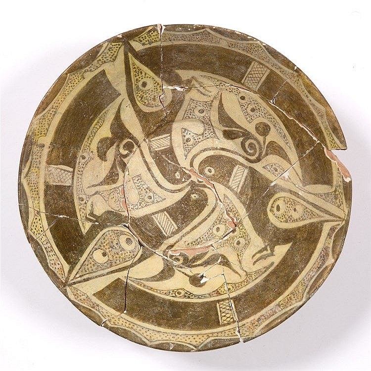 A Persian slip-decorated bowl