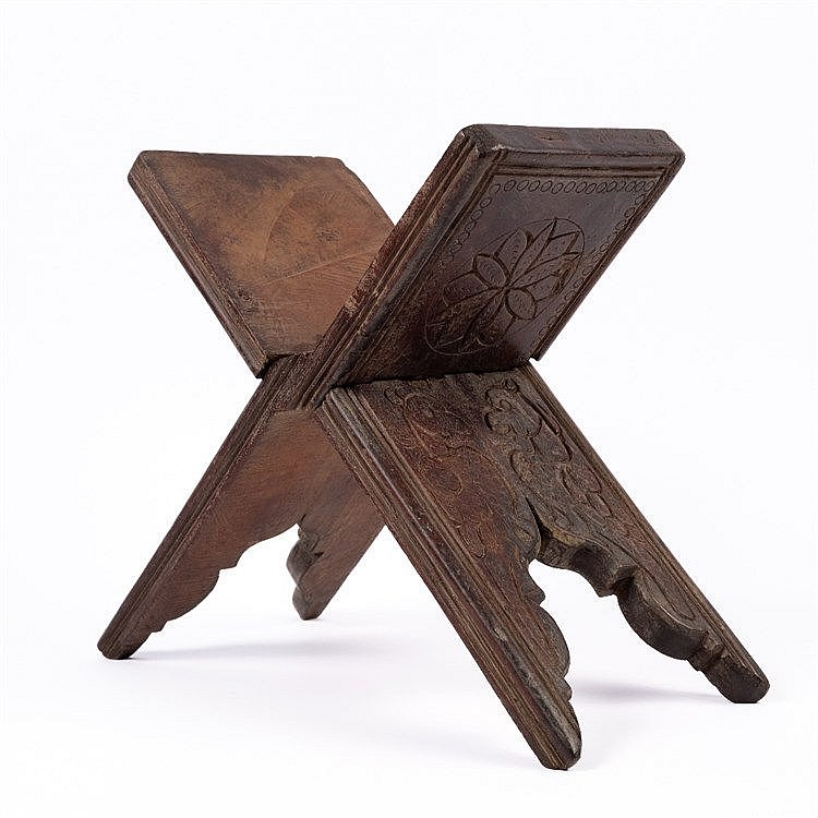 An Indian carved wooden manuscript stand