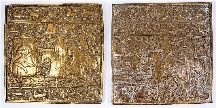 A pair of Qajar embossed brass panels