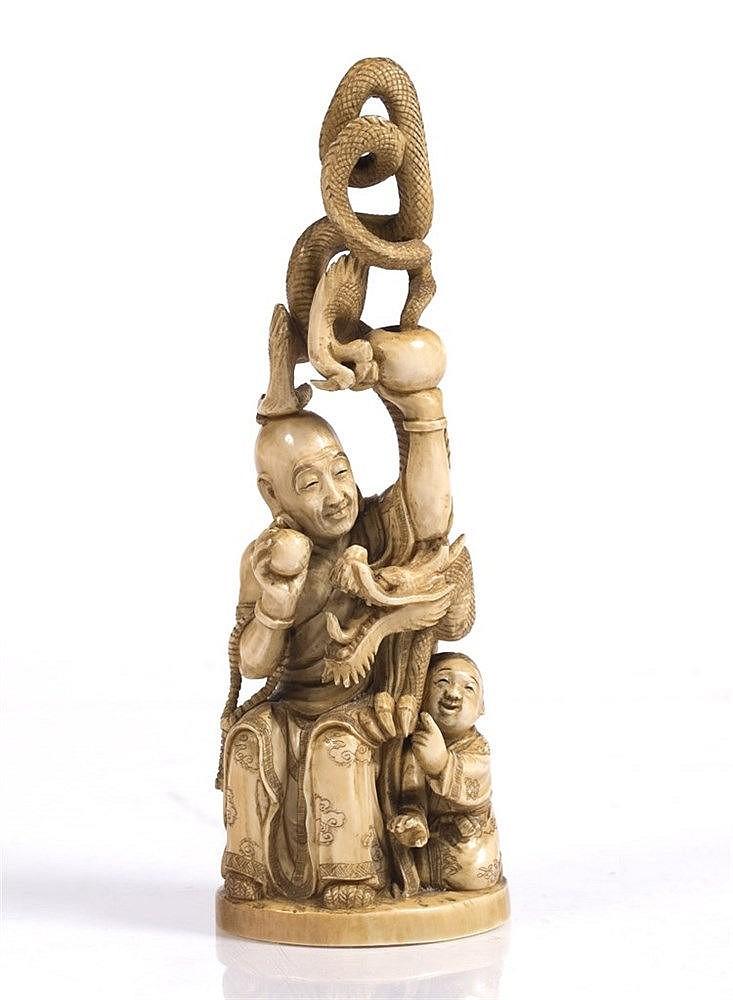 A Japanese ivory okimono of a Handaka Sonja
