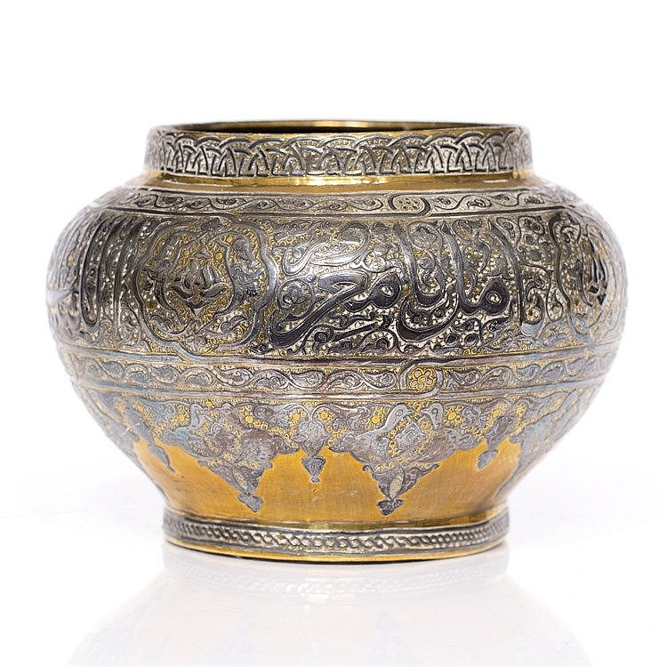 A Cario ware brass and silver metal bowl