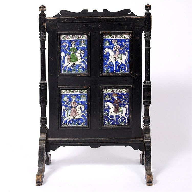 A wooden screen inset with four Qajar tiles