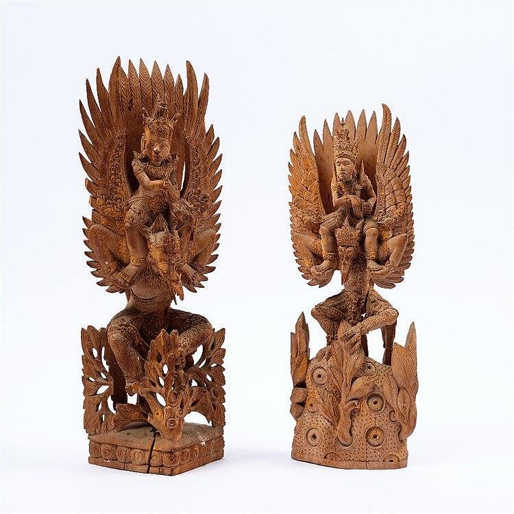 A pair of Balinese carved mythological Gods