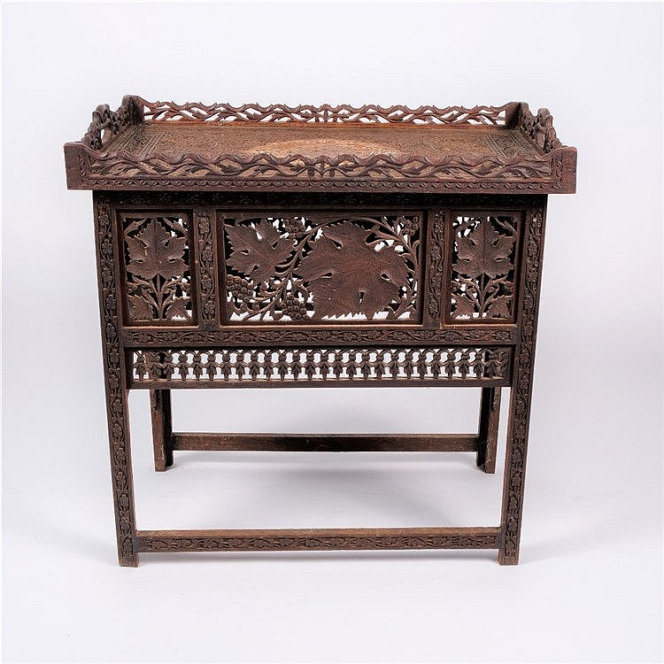 An Indian carved hard wood occasional table