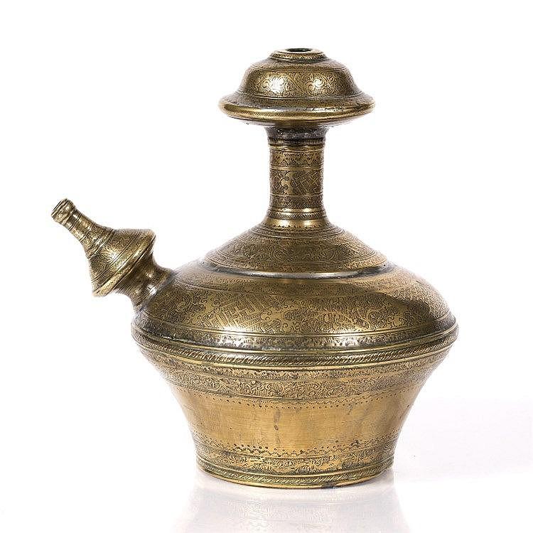 An Indian brass Kendi