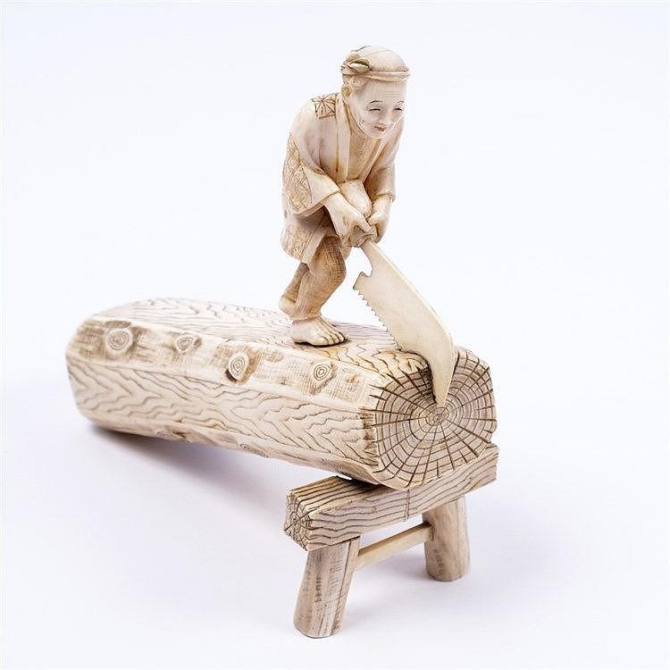 A Japanese ivory okimono of a carpenter