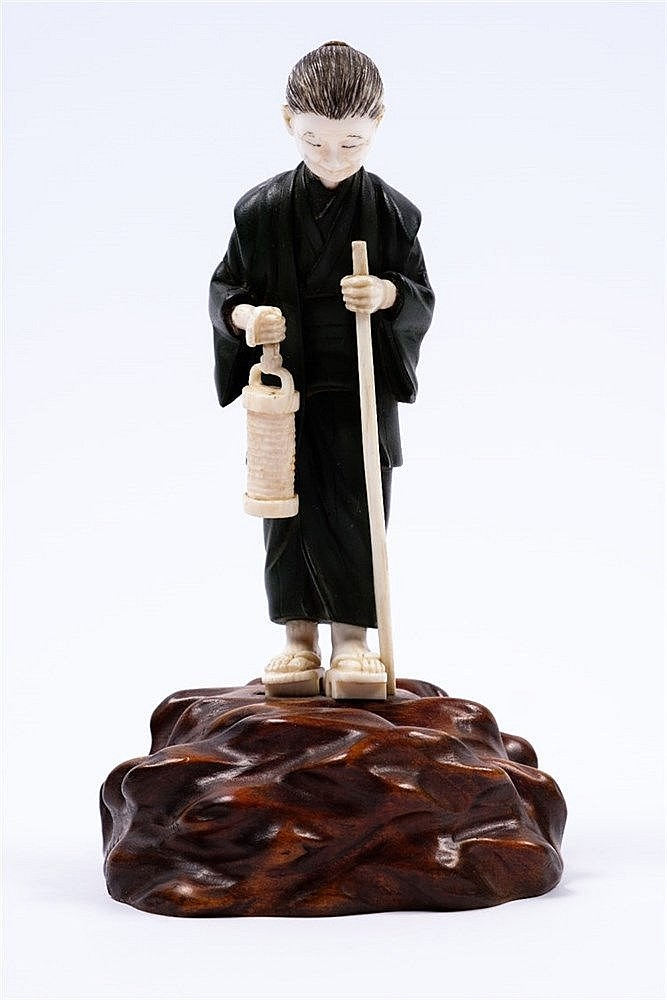 A Japanese bronze and ivory figure of a standing elderly lady