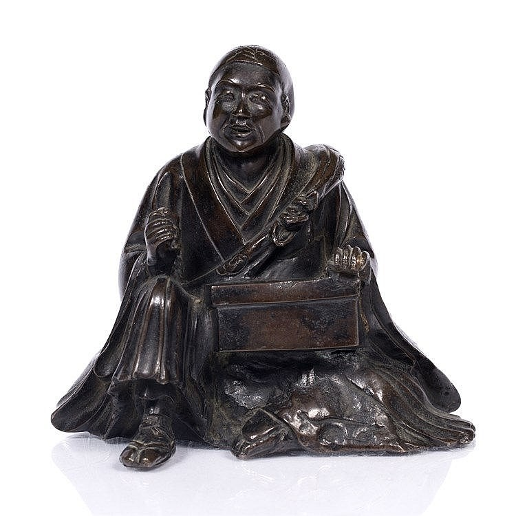 A Japanese bronze model of a seated priest