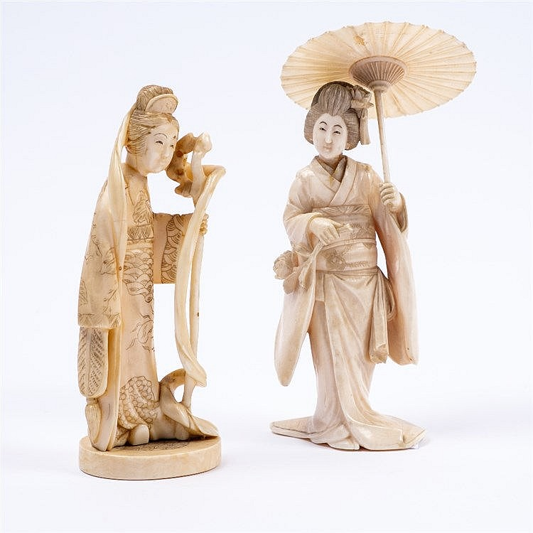 A Japanese ivory okimono carved as a standing Geisha