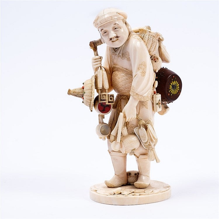 A Japanese ivory okimono of an itinerant vendor or street entertainer