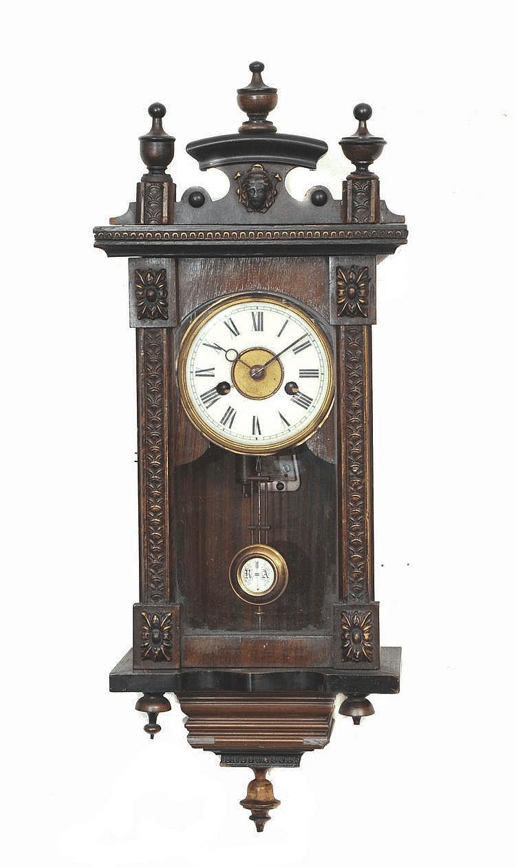 A SMALL GERMAN WALL CLOCK having a Roman dial,