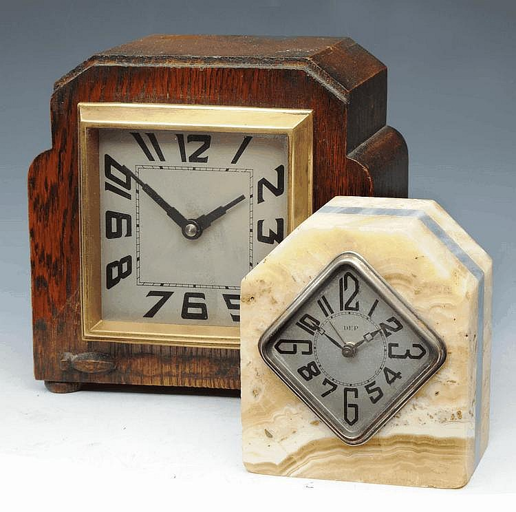 A FRENCH ART DECO ONYX AND GREY MARBLE ALARM CLOCK