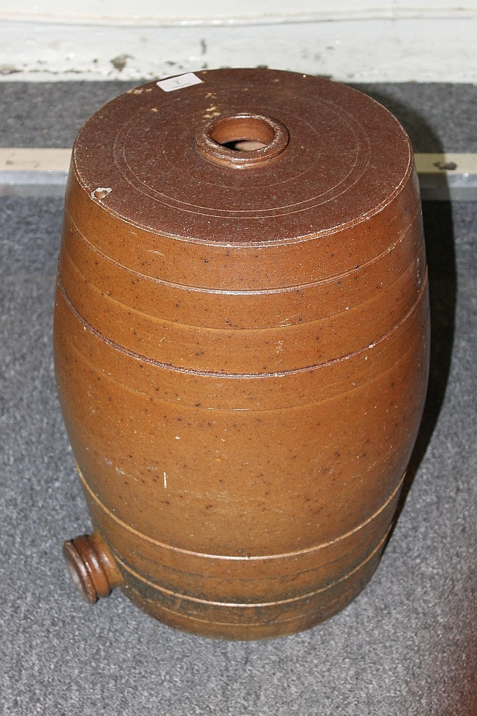 A CERAMIC BARREL of usual form with salt glazed