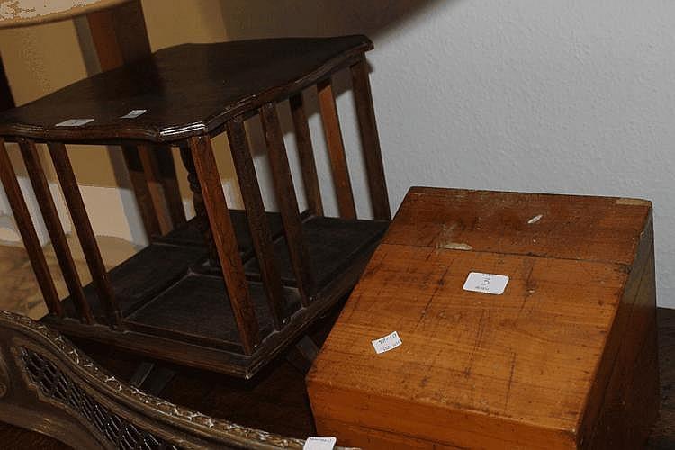 A SMALL TABLE TOP REVOLVING BOOKCASE, a dumb