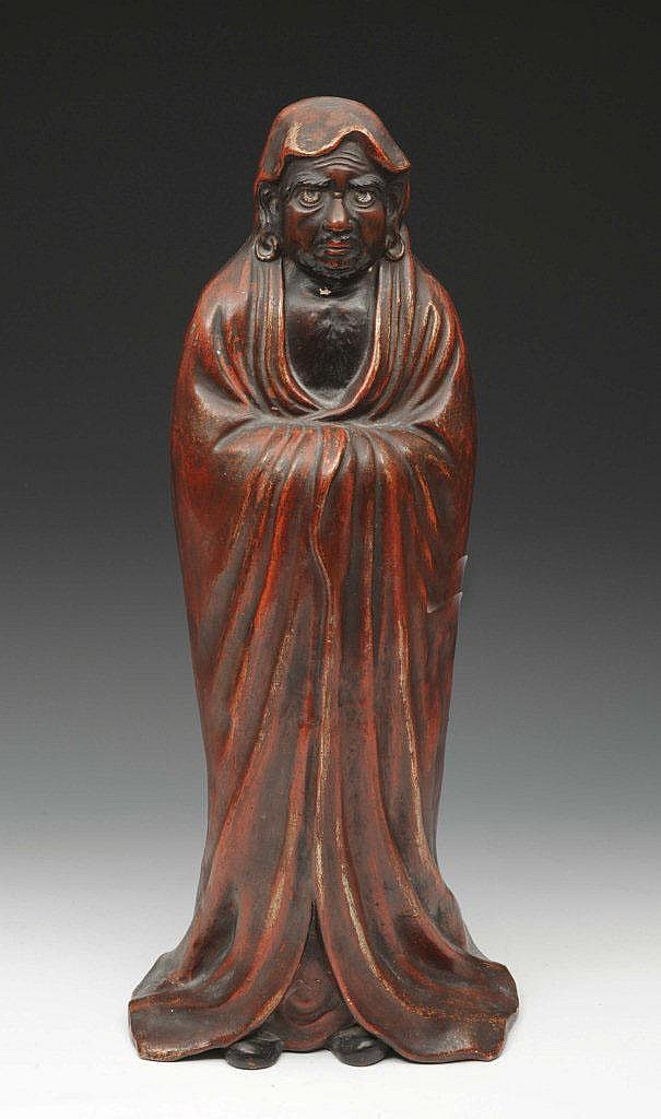 A JAPANESE FIGURE of a standing Daruma in red