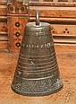 AN ANTIQUE BRONZE MIDDLE EASTERN BELL with loop