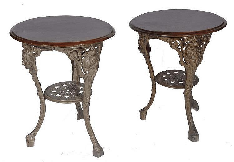 A PAIR OF VICTORIAN CAST IRON PUB TABLES with