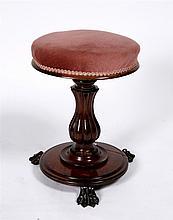 A Regency rosewood circular piano stool