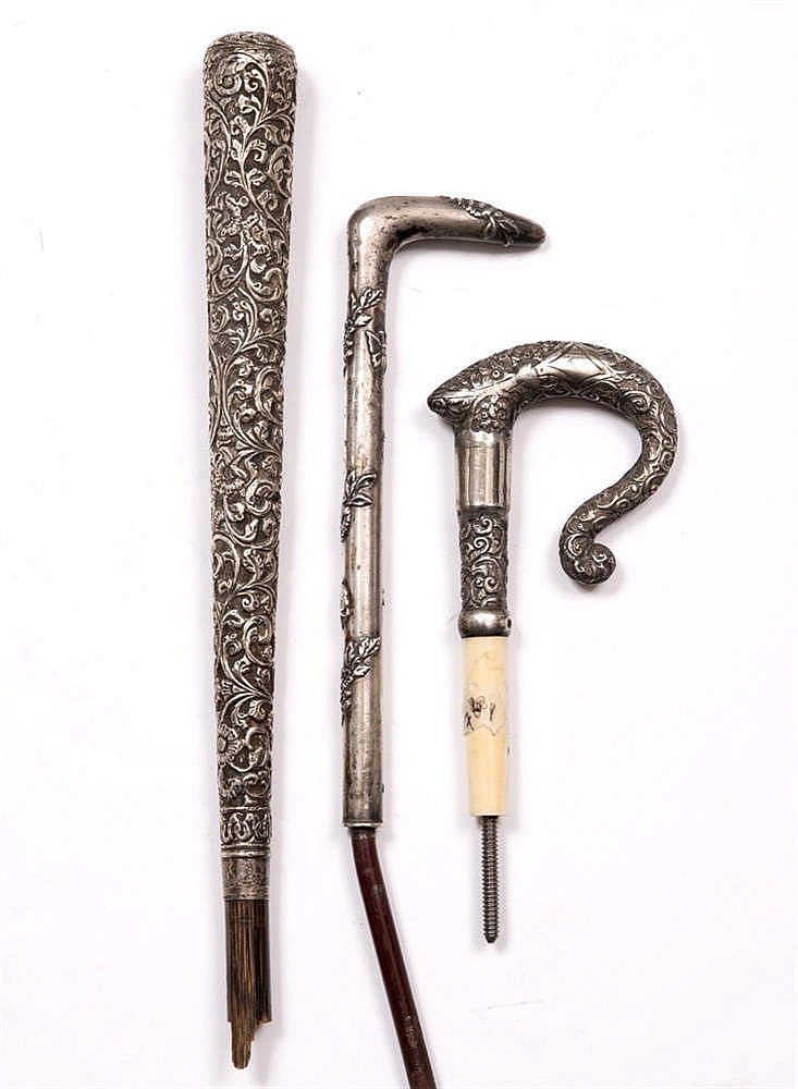 A 19TH CENTURY INDIAN CANE HANDLE with intricate scrolling foliate ornament