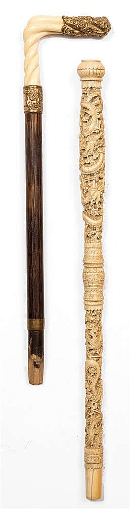 A 19TH CENTURY CHINESE CARVED IVORY CANE HANDLE with intricate scrolling dr