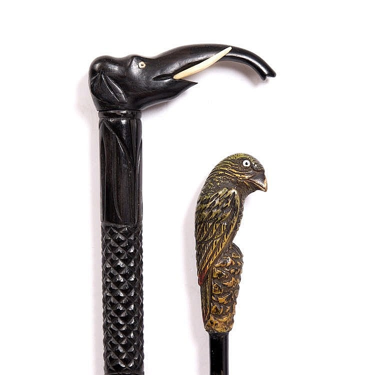 AN INDIAN EBONY CANE with hatched and spiral carved shaft and elephant head
