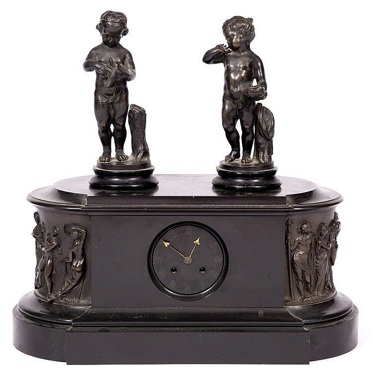 A HEAVY BLACK SLATE VICTORIAN MANTEL CLOCK with French striking mechanism a