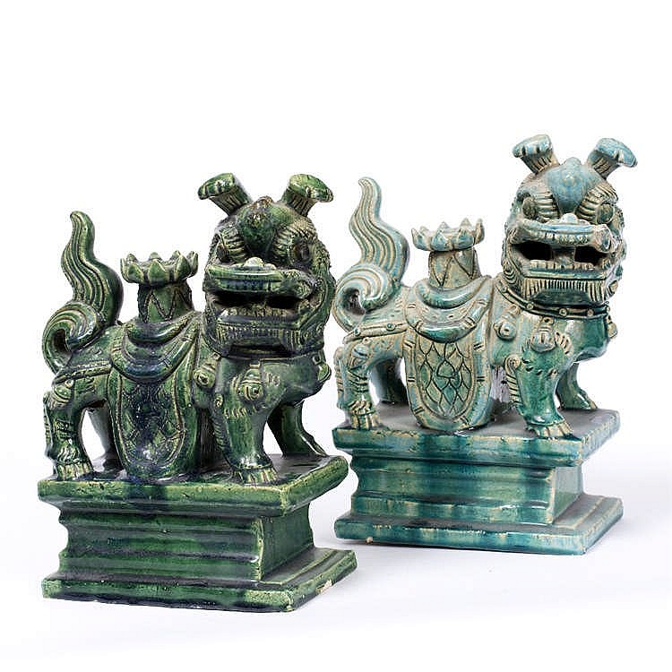 TWO CHINESE GREEN GLAZED POTTERY ROOF TILES each in the form of a Qilin on