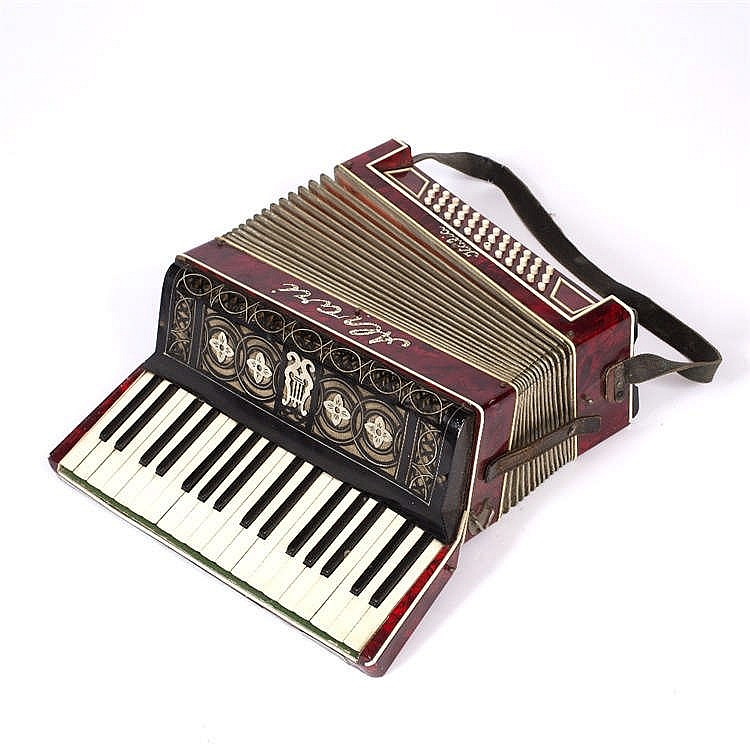 A VINTAGE ITALIAN ALVARI ACCORDION with red simulated tortoiseshell case, k