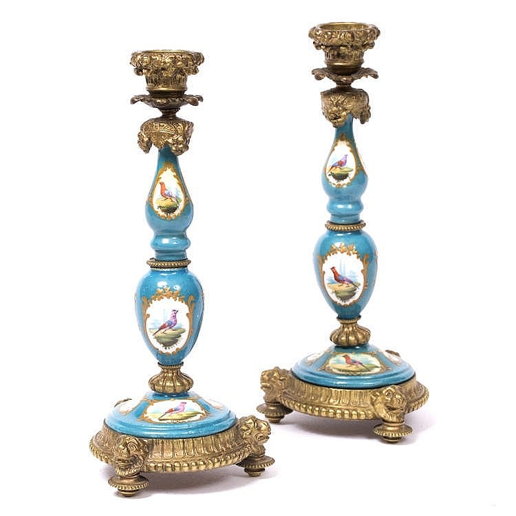 A PAIR OF 19TH CENTURY FRENCH PORCELAIN AND GILT METAL MOUNTED CANDLESTICKS