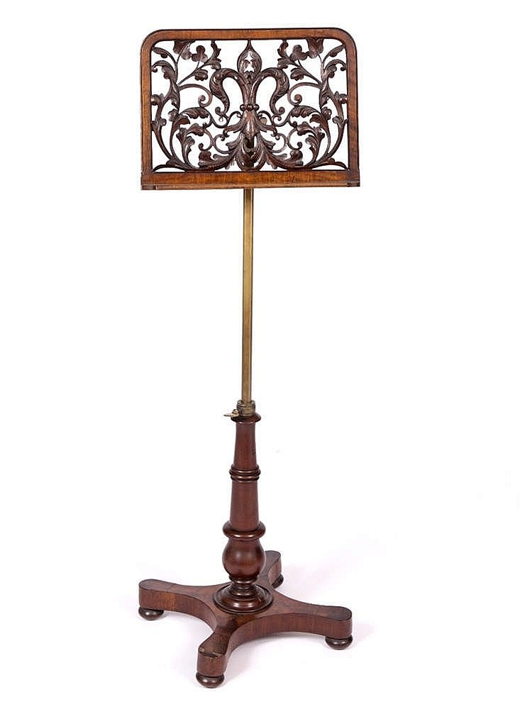 A VICTORIAN MAHOGANY MUSIC STAND, the music rest with swivel adjustment and