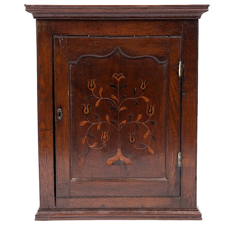 AN 18TH CENTURY OAK WALL CUPBOARD, the panelled door inlaid with a stylised