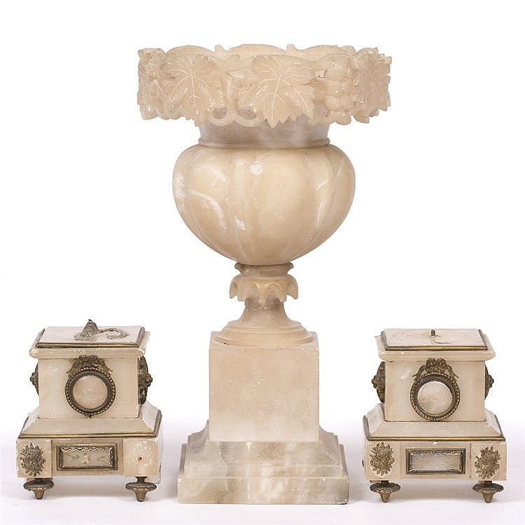 AN ALABASTER URN of classical form with trailing grapevine decoration, 35cm