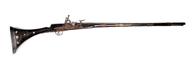 AN ANTIQUE AFGHAN FLINTLOCK RIFLE with pressed brass and mother of pearl in