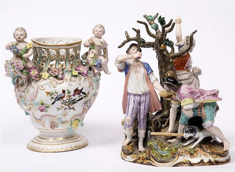 A 19TH CENTURY MEISSEN PORCELAIN GROUP of three figures gathered around a t