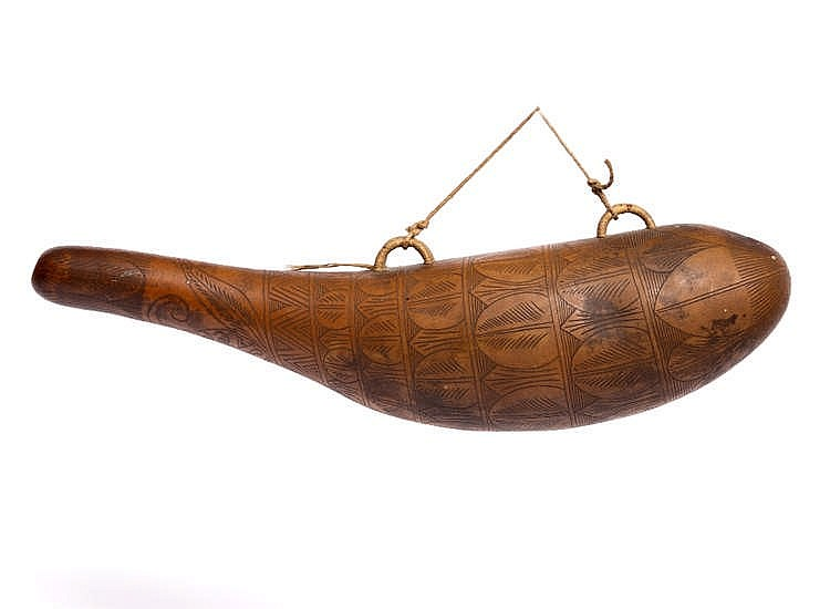 A SCRATCH CARVED GOURD with stylised banded decoration and carved Ajaccio,