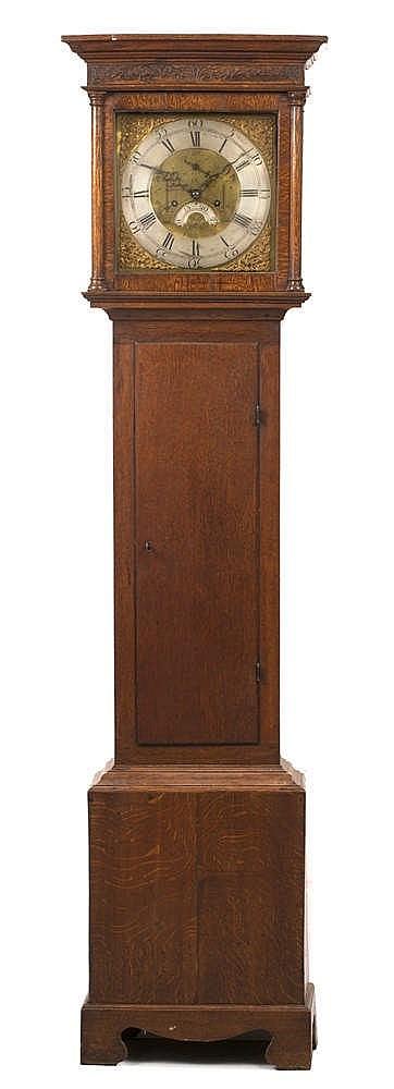 ADAM CLEAK, BRIDPORT An oak eight day longcase clock, the 12