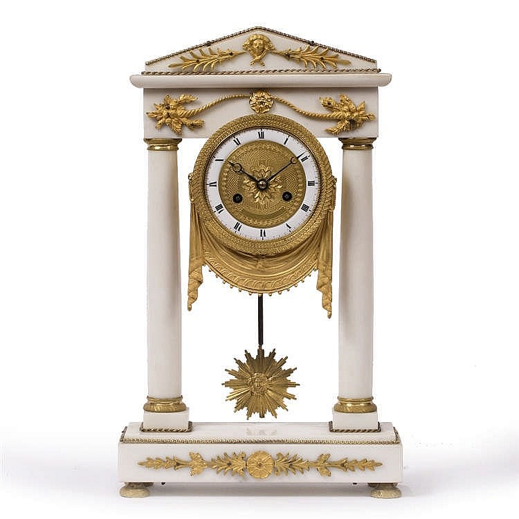 A FRENCH EMPIRE ALABASTER AND ORMOLU PORTICO CLOCK the engine turned dial w